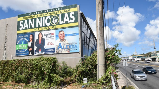 Campaign signs for Democratic senatorial candidates are posted on a building in Tamuning on April 16.