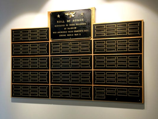Damaged World War II plaque discovered in former elementary school, restored to honor 165 men who fought in war