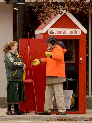 Bell ringer Tom Drill, right, visits with Margret Pauwels of rural Whitelaw during his shift in downtown Manitowoc in 2014.