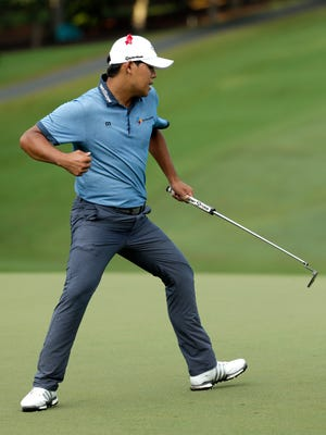 Si Woo Kim reacts to making a birdie putt on the 18th hole and winning the Wyndham Championship golf tournament Sunday in Greensboro, N.C.