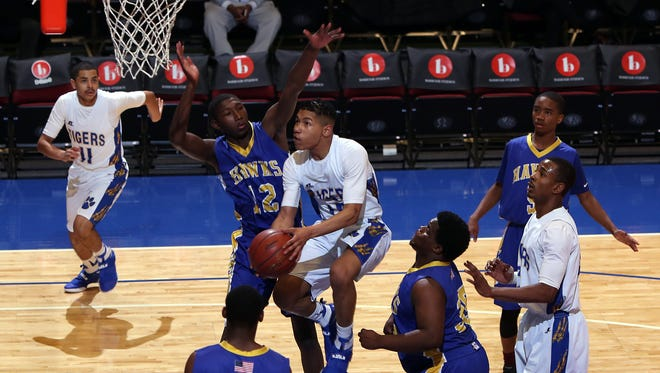 Children's Village's Trent Dance attempts to block Martin Luther King's Kaywon Green in the Class D semifinals at the Westchester County Center, Feb. 27, 2017.  Martin Luther King won, 67-40.