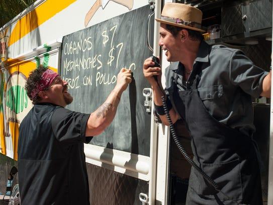Jon Favreau (left) and John Leguizamo man a food truck