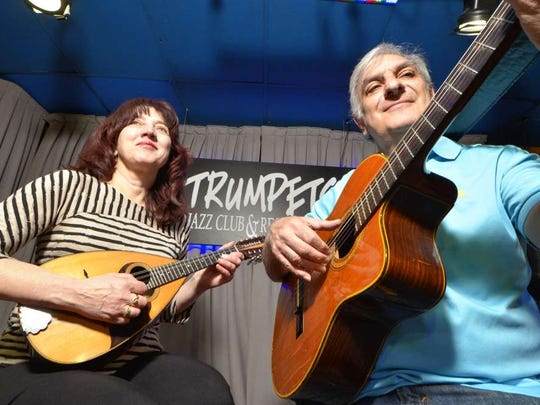 Trumpets Jazz Club owners Kristine Massari, left, and Enrico Granafei, playing with the Bloomfield Mandolin Orchestra.