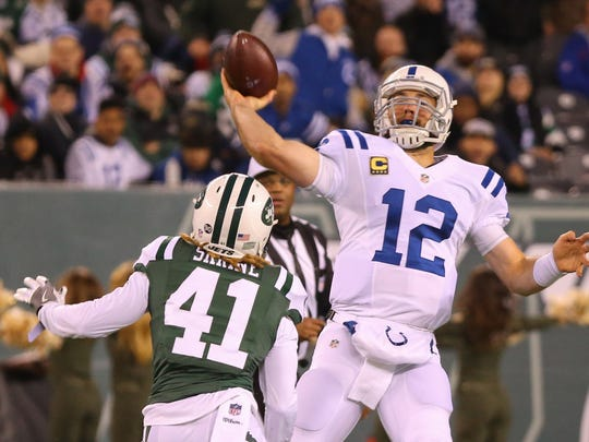 Indianapolis Colts quarterback Andrew Luck (12) throws a pass during the first half against the New York Jets at MetLife Stadium. (Ed Mulholland-USA TODAY Sports)