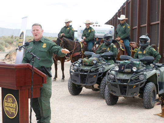 Aaron Hull, chief patrol agent of the Border Patrol's El Paso Sector, speaks during a news conference in Santa Teresa, New Mexico, as construction of a new border wall section began.