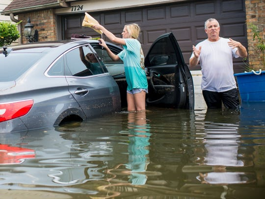 Jenna Fountain and her father Kevin check her flooded