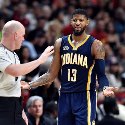 Indiana Pacers forward Paul George (13) reacts after