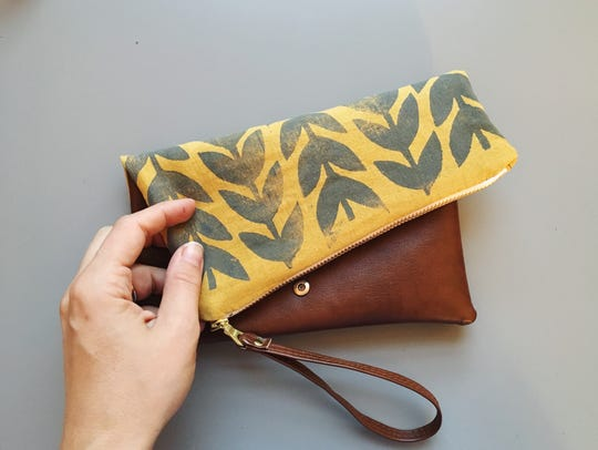 Jenna Aliyah's Athens folded vegan leather clutch for