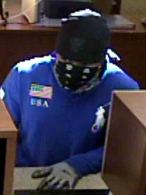 Surveillance photo of a man suspected of robbing the United Bank of El Paso del Norte at 125 N. Mesa Hills Drive on Sept. 9.