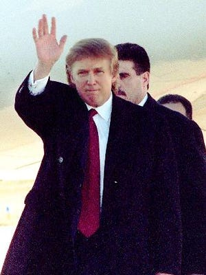 Donald Trump waves to the media after getting off his jet in 1999 at what is now Springfield-Branson National Airport. He was on his way to Branson, where his Miss USA pageant was being held.