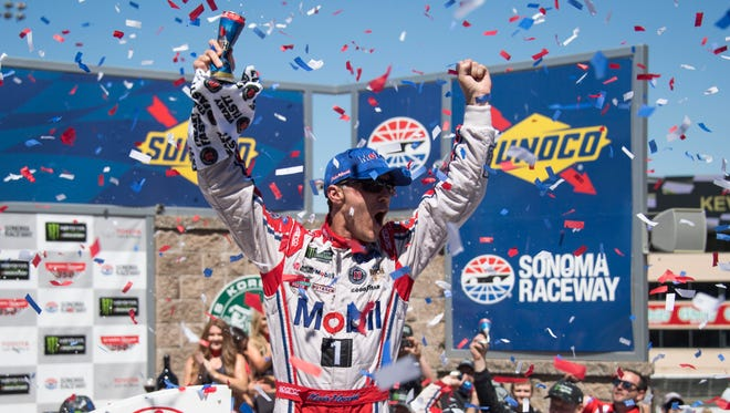 Kevin Harvick celebrates in victory lane after winning the Toyota/Save Mart 350 Sunday at Sonoma Raceway.
