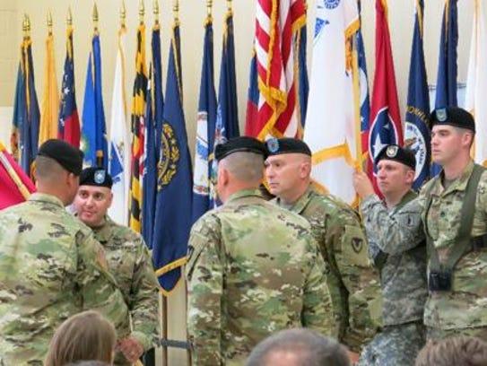 Lt. Col. Jeffrey Ignatowski, center, receives the Letterkenny