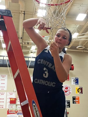 Central Catholic senior Emily Burks cuts down the net after scoring nine points in the final 1:44 to help Central Catholic win the Class A semistate.