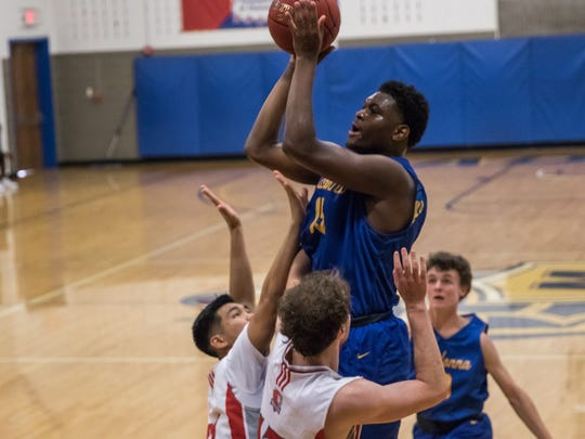 Eyeing the rim during a recent game is Madonna University forward Davon Taylor. The Canton alum came over to the Crusaders after playing two seasons at Schoolcraft College.