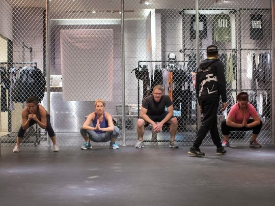 A workout class takes place at ConBody Bootcamp Studio