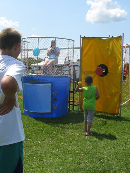 The AutismUp organization presented a family-friendly festival at Penfield's Rothfuss Park on August 9th, 2014.