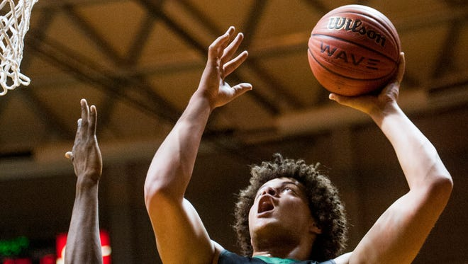 Pelham's Alex Reese (3) shoots against Wetumpka at the AHSAA Regional Basketball Championships on the Alabama State University campus in Montgomery, Ala. on Friday February 17, 2017.