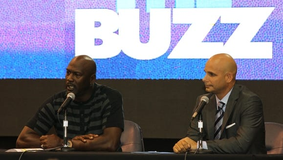 Rochester native Pete Guelli, right, and Charlotte Hornets owner Michael Jordan talk during a  news conference. Guelli is the team an executive vice president with the team and its chief marketing and business officer.