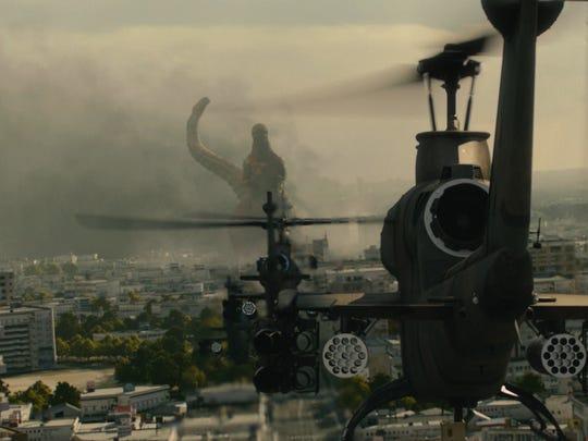 """Godzilla under fire in a scene from """"Shin Godzilla."""""""