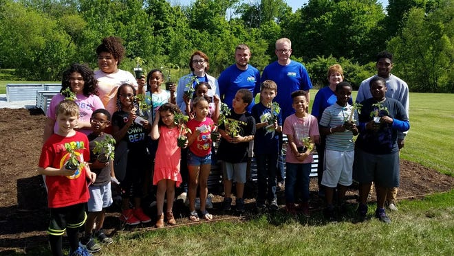 Local businesses partnered with the Mansfield Area Y by donating nonperishable food and helping with the Y's community garden to provide free and nutritious snacks to children this summer.