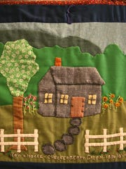 Milton's first town house was completed in late 1805 and was used for the town meeting in March 1806. This depiction is shown on a single square of a quilt that tells the story of the history of Milton. The quilt was created in 1982 by members of the community to commemorate the 200th anniversary of the arrival of the first five settlers of Milton. The quilt is on permanent display at the Milton Historical Museum.