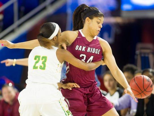 Oak Ridge's Mykia Dowdell knocks the ball out of Memphis