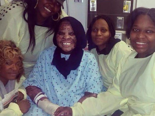 Francine Wallace is surrounded by two of her daughters and two friends in January, when she left to go home after months in hospitals and nursing homes.