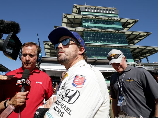McLaren-Honda-Andretti IndyCar driver Fernando Alonso (29) does his television interviews while watching Alexander Rossi run for the pole during Armed Forces Pole Day Sunday, May 21, 2017, afternoon at the Indianapolis Motor Speedway.