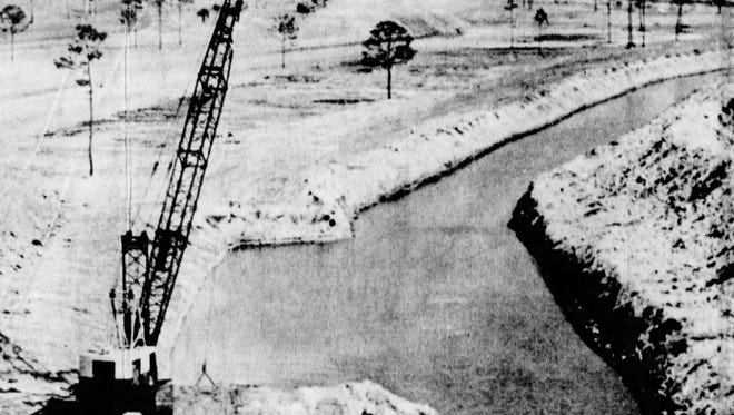 Gigantic tree mashers crushed the pines and palmettos and floating hydraulic dredges dug up and pumped out submerged earth to canal depths of from 6- to 15-feet.