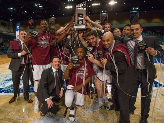The Montana team celebrates its win over Eastern Washington in the Big Sky Championship NCAA college basketball game in Reno, Nev., Saturday, March 10, 2018. (AP Photo/Tom R. Smedes)