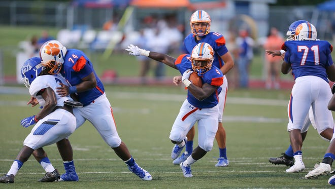Madison Central's Gabe Short (4) finds a hole in the Meridian defense in the first quarter. Madison Central and Meridian played in the 2016 football season-opener at Madison Central on Friday, August 19, 2016. Photo by Keith Warren