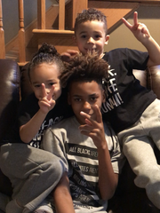 Drew, age 4, Nyiaar, age 12, Kane, age 6, relaxing at home.