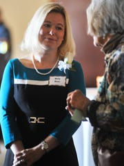 Inductee Molly Moen mingles during Tuesday's Annual 25-Year Club and Retirement Banquet at the Jefferson Street Inn in downtown Wausau.