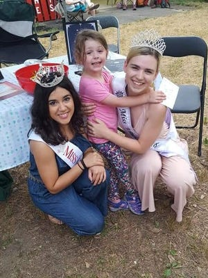 Miss Cumberland County Olivia Cruz (left) and MissVineland Sarah Layton greet a guest during the Cumberland County Fair.
