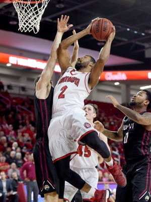 USD's Carlton Hurst goes up for shot while IUPUI's Josh James guards during their game at USD Sanford Coyote Sports Center on Saturday in Vermillion.