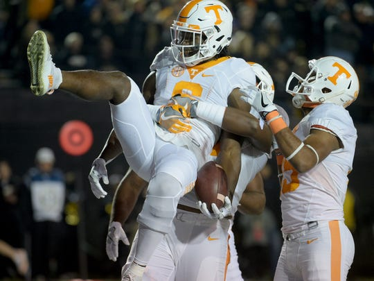 Tennessee running back Alvin Kamara (6) is hoisted by his teammates after scoring a TD in the game between Vanderbilt and Tennessee at Vanderbilt Stadium Saturday, Nov. 26, 2016, in Nashville, Tenn.