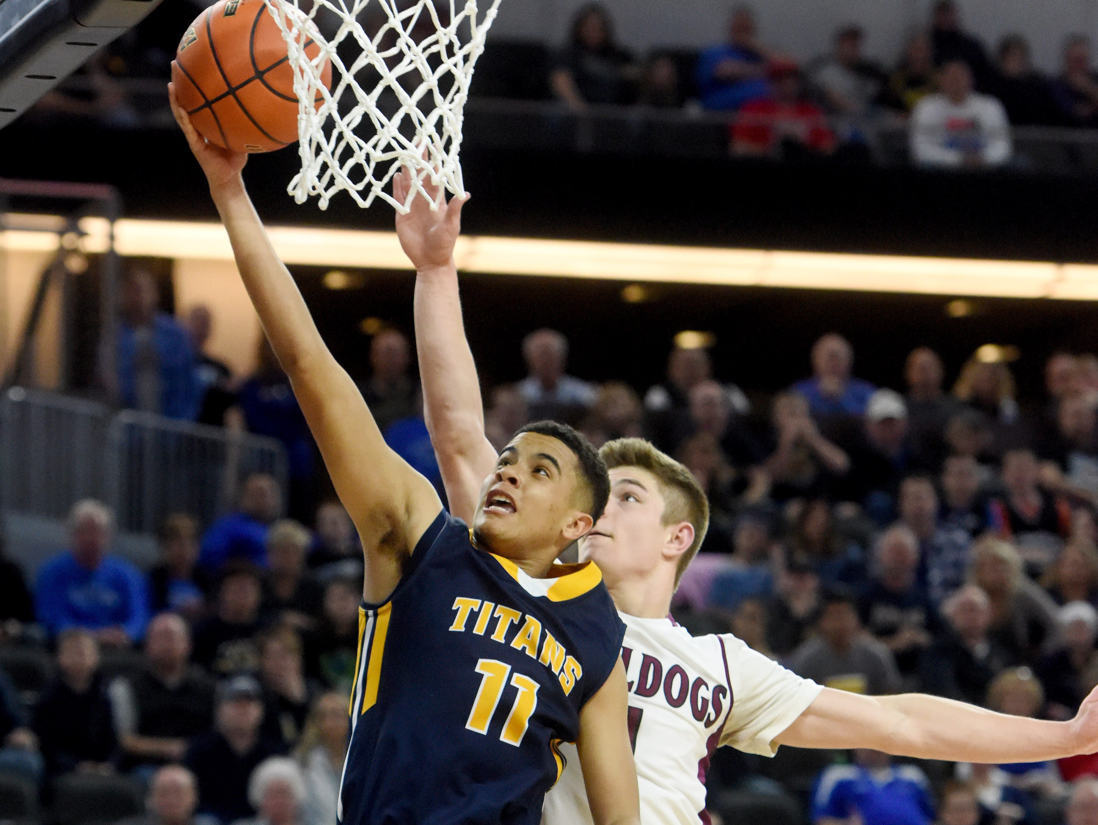 Tea Area's Justin Hohn-Mack goes up for a shot while Madison's Jaxon Janke defends during the 2017 SDHSAA Class A boy's basketball championship at the Denny Sanford Premier Center on Saturday, March 18, 2017.