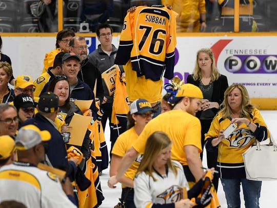 A fan shows his excitement after receiving Predators defenseman P.K. Subban's jersey after their last home game of the season at Bridgestone Arena Tuesday, April 4, 2017 in Nashville, Tenn.