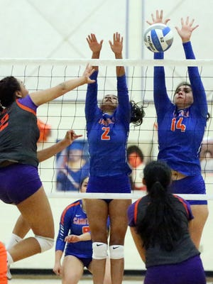 Eliana Arellano, 14, of Canutillo blocks a shot by Kimberly Hernandez, 2, of Eastlake Tuesday night. Also defending was Divine Avila, 2. Canutillo won at home in five sets.