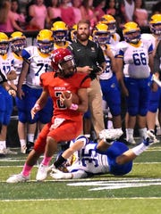Tyler Porter (2) spins out of a tackle for Newport, Oct. 20, 2017.