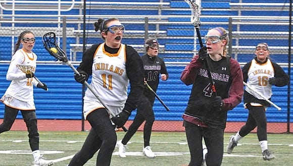 Mahopac's Natalie Scanlon carries the ball in 2017 as Scarsdale's Emma Coleman (r) defends.