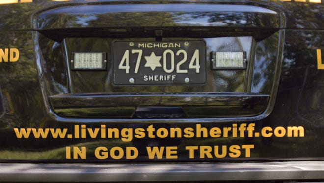 "Many of the vehicles driven by deputies in the Livingston County Sheriffs Dept. now have the words ""In God we trust"" printed on them."