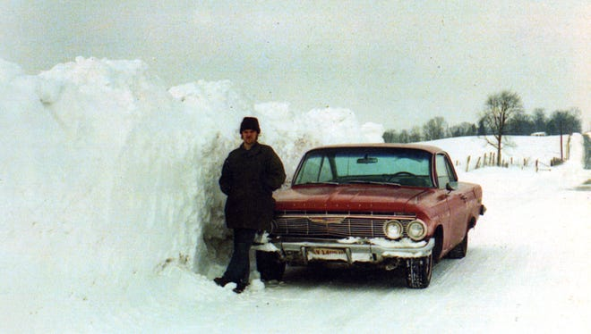 Chris Northrup and his neighbor Ernie Tubbs had heard Ohio 666 north of Zanesville had large snow drifts after the Blizzard of 1978, and after the road was cleared they went out to see for themselves. Northrup took a picture of his neighbor standing next to a drift near the state nursery.