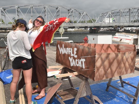"""Sisters Brittany Hunt and Arie Hunt, from left, both of Sturgeon Bay, get their costumes ready as they prepare to take their """"Waffle Yacht'' into the Sturgeon Bay canal for the Sikaflex Challenge sea trials at last year's Door County Classic and Wooden Boat Show."""