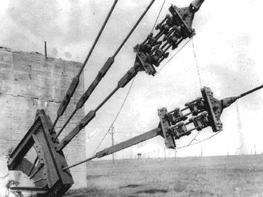 Guy wires of the Tuckerton Tower are anchored to one of three 20-foot high concrete blocks