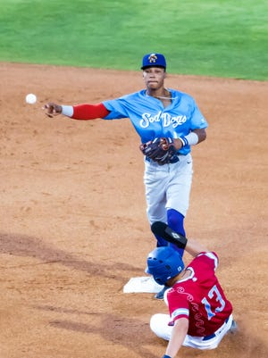 Amarillo Sod Dogs second baseman Mack Chambers (top) throws to first base for a double play as Tulsa Drillers Alec Sanchez slides in during Wednesday night's game at Hodgetown.