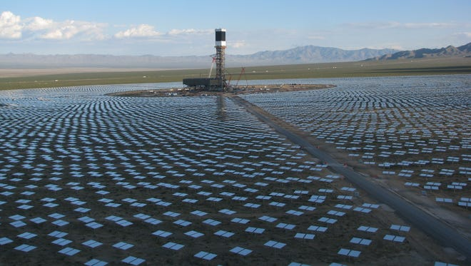 A 459-foot solar tower, surrounded by thousands of reflecting mirrors, is one of three towers about to go online at BrightSource Energy's Ivanpah solar project in east San Bernardino County.