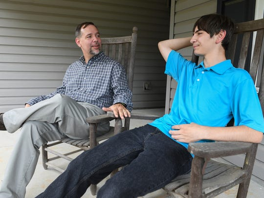 James Campbell talks with his sone Jonathan, 13, at