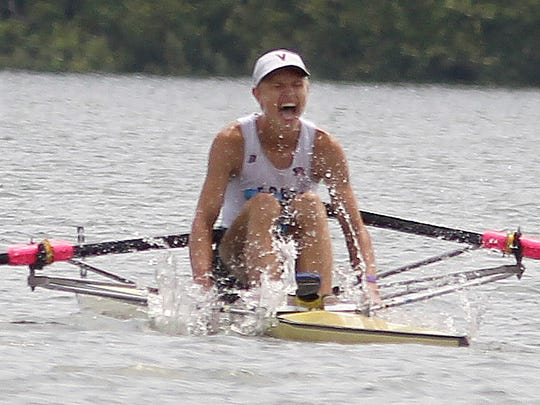Mark Conwenhoven, of the Vesper Boat Club, Philadelphia, celebrates his win in the men's single scull 2000 meter race at the 2015 USRowing Club Nationals at Harsha Lake, East Fork State Park, Clermont County.