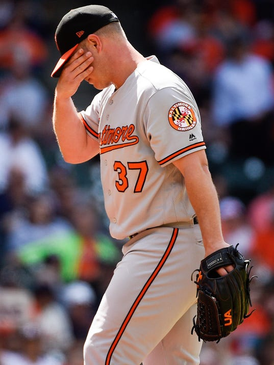 Baltimore Orioles starting pitcher Dylan Bundy walks back to the mound after walking Houston Astros' Max Stassi during the sixth inning of a baseball game, Wednesday, April 4, 2018, in Houston. (AP Photo/Eric Christian Smith)